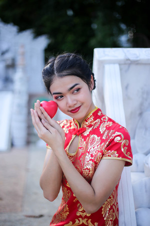 Beautiful asian woman holding dollars or money with lucky pocket money,in the Chinese New Year. Festivities, New Year Celebration  concept. Stock Photo