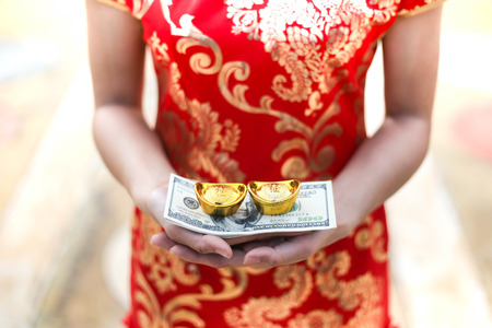Beautiful asian woman holding dollars or money with lucky pocket money, in the Chinese New Year. Stock Photo