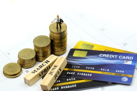 Miniature people : businessman with credit card and stack coins, commitment, agreement, investment, business and partnership concept
