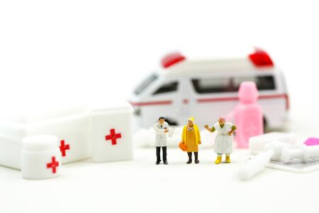 Miniature people : Doctor and Paramedic attending to patient in ambulance,Medicine ambulance concept Stock Photo