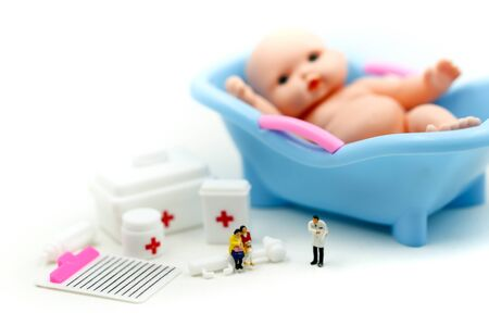 Miniature people : doctor and people wait for child want to become parents soon. Maternity, pregnancy concept.