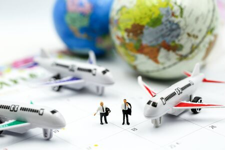 Miniature people : sitting with airplane,for travel around the world concept.