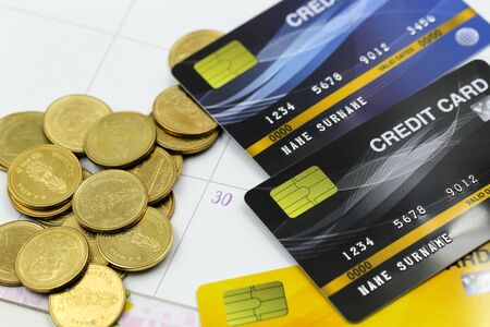 Credit card with Stacks of coins  golden sparkle