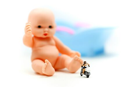 Miniature people : couple in love wait for child want to become parents soon. Stock Photo