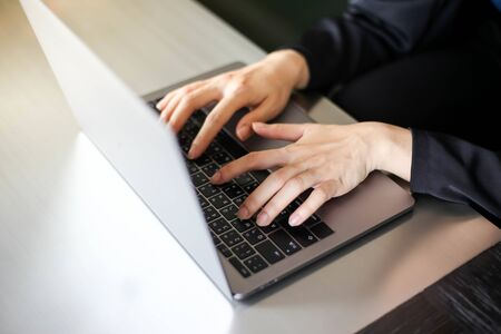 Close up of business women working with typing on laptop empty at workplace.Selective focus,business woman using laptop, searching web, browsing information Archivio Fotografico - 132748450