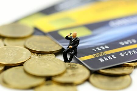 Miniature people : businessman with credit card and stack coins,commitment, agreement, investment, business and partnership concept Archivio Fotografico - 133205200