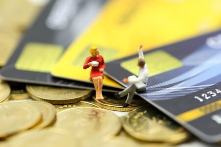 Miniature people : businessman with credit card and stack coins,commitment, agreement, investment, business and partnership concept Archivio Fotografico - 133205203