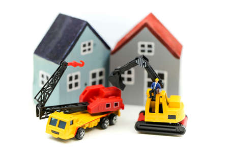 Miniature people : worker team for building home ,Image use for construction, business concept,house repair or home renovating 版權商用圖片