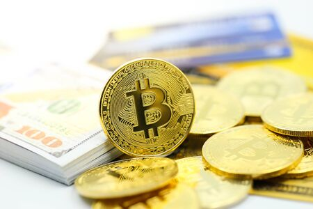 Bitcoins with credit card of dollar banknote,accepting bitcoin for payment, Electronic money exchange concept.