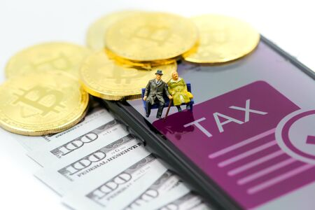 Bitcoin Crypto Currency with TAX message and dollars money, Determining the tax law of digital money Concept