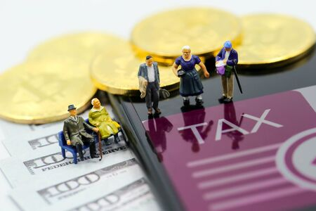 Miniature people : Old man  Bitcoin Crypto Currency with TAX message and dollars money, Determining the tax law of digital money Concept