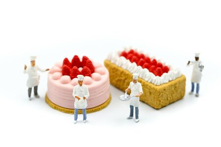 Miniature people : Chef and friend with Sweet dessert, cooking and decoration concept.