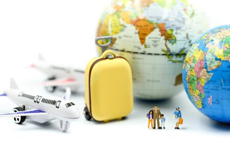 Miniature people : traveler  with airplane, for travel around the world concept.
