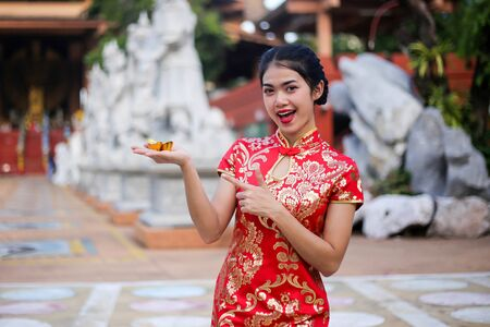 Beautiful asian woman holding dollars or money with lucky pocket money, in the Chinese New Year.
