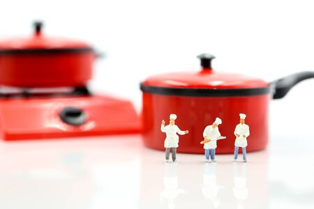 Miniature people : Cook chef in kitchen interior with kitchenware Archivio Fotografico - 133955681