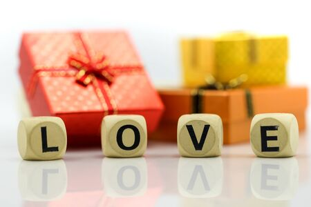 Love text wooden blocks with rose and gift box, Lover concept. Archivio Fotografico - 133955678