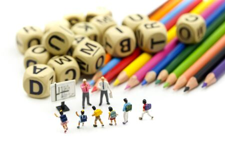 Miniature people : children and student with stationary, education concept. Archivio Fotografico - 133955695