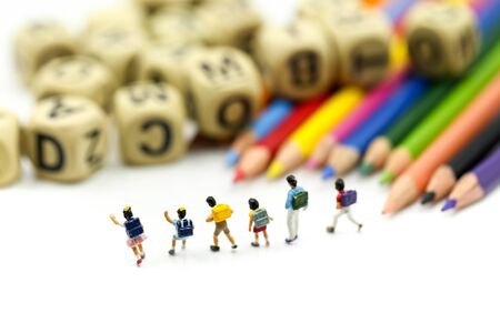 Miniature people : children and student with stationary, education concept. Archivio Fotografico - 133955818
