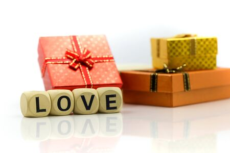 Love text wooden blocks with rose and gift box,Lover concept. Archivio Fotografico - 133955821