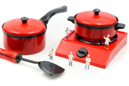 Miniature people : Cook chef in kitchen interior with kitchenware Archivio Fotografico - 133955830