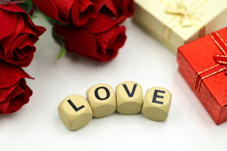 Love text wooden blocks with rose and gift box, Lover concept.