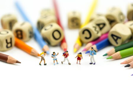 Miniature people : children and student with stationary, education concept. Stock Photo