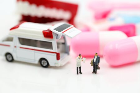 Miniature people : Doctor and Paramedic attending to patient in ambulance,Medicine ambulance concept Archivio Fotografico - 133955974