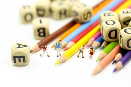 Miniature people : children and student with stationary,education concept. Archivio Fotografico - 133956346