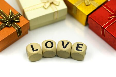Love text wooden blocks with rose and gift box, Lover concept. Archivio Fotografico - 133956345