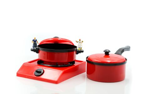 Miniature people : Maid or Housewife cleaning and Cook chef in kitchen interior with kitchenware