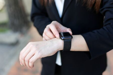 Beautiful Young businesswoman   looking at her smart watch Archivio Fotografico - 133956097