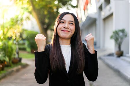 Portrait of Young beautiful Asian business woman felling happy or success working. Archivio Fotografico - 133956100