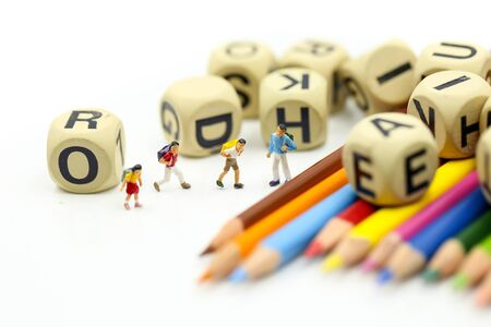 Miniature people : children and student with stationary, education concept. Archivio Fotografico - 133956103