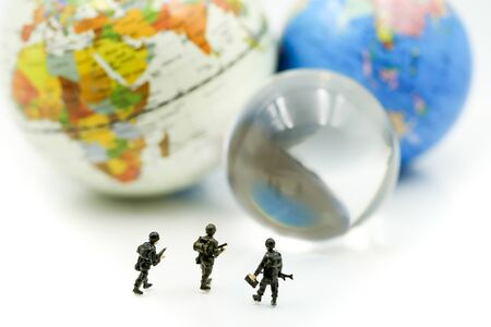 Miniature people : soldiers team with world map,War, army, military, guard concept. Stok Fotoğraf