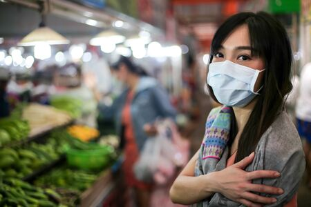 Beautiful asia woman wearing mouth mask against air smog pollution PM 2.5 写真素材