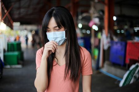 Beautiful asia woman wearing mouth mask against air smog pollution PM 2.5 Reklamní fotografie