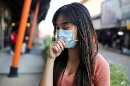 Beautiful asia  Woman suffer from sick and wearing face mask  protect filter against air pollution