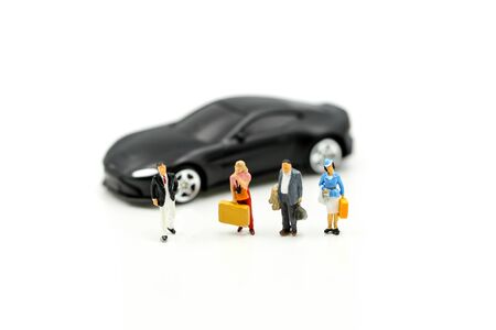 Miniature people : traveler with car, Concept for travel around direction to destination with car dealer, cars exhibition show
