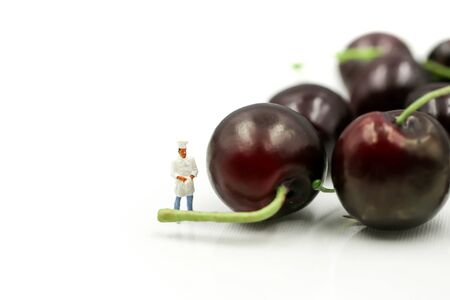 Miniature people : chef with cherries