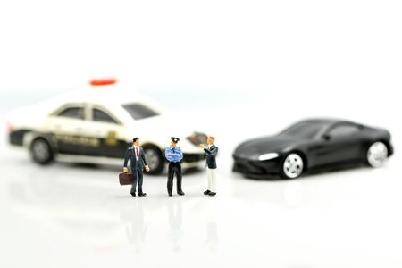 Miniature people : Police officer emergency service car driving street,car crash accident damaged