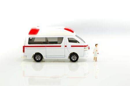 Miniature people : Doctor and Nurse emergency medical team with pills and Ambulance