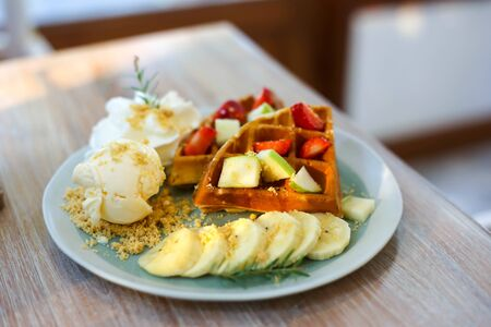 Waffle of fresh berries strawberry, blueberry, bananas and chocolate topping