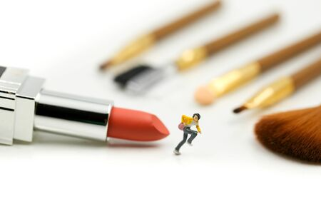 Miniature people : beautiful woman and Makeup products with cosmetic Stock fotó