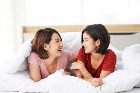 Couple love lesbian happy couple waking up in morning,LGBT Lesbian couple together indoors concept.