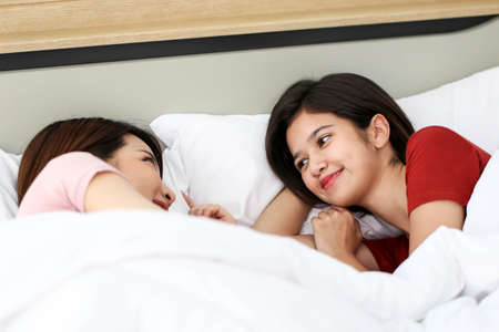 Couple love happy couple waking up in morning,LGBT Lesbian couple together indoors concept.