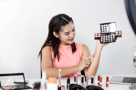 Asian woman beauty blogger or vlogger review cosmetic product Online influencer girl social media marketing.