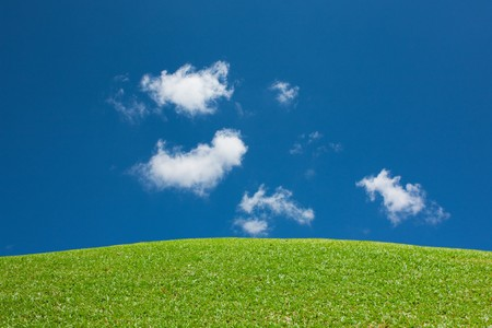 Green grass mountain clear sky view Stock Photo - 7347328