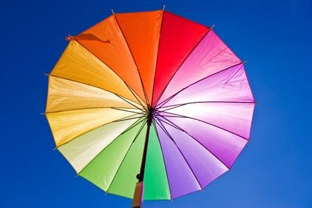 Sunblock via colorful rainbow umbrella photo