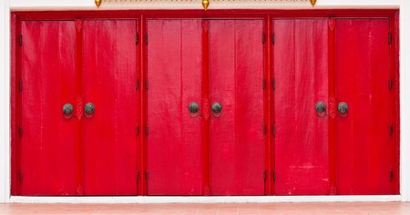 Triple Red Doors with Lion head Knobs photo
