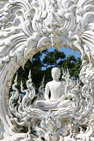 mnich: White monk meditation statue in Chiangrai Rong Khun temple, northern of Thailand.